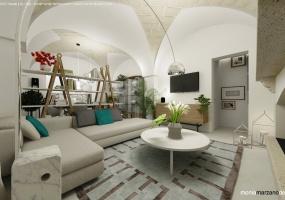 foto di un salotto arredato con mobili in colori naturali e materiali ricercati con arredamento unico situata in Salento precisamente in Santa Maria di Leuca