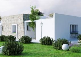 foto di un giardino e di una villa in parte rivestita in pietra con prato inglese in salento precisamente ubicata in Santa Maria di Leuca