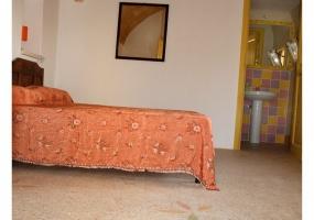 foto di una camera da letto arredata situata in salento precisamente in Ruggiano di salve