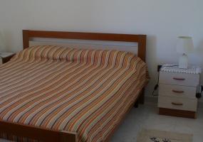 questa è la foto di una camera da letto di una casa vacanze in torre pali