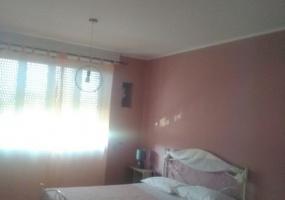 nella foto vediamo una camera da letto finemente arredata in Torre Pali