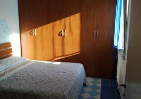 nella foto vediamo una camera da letto in una casa vacanze in Pescoluse di Salve provincia di Lecce