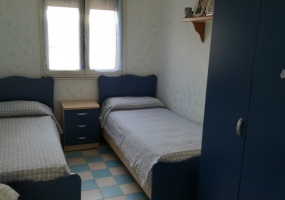 nella foto vediamo una cameretta di una casa vacanze in Salve nella marina di Pescoluse