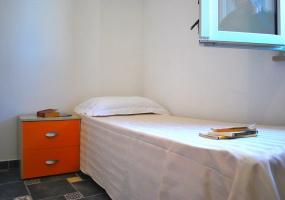 nella foto vediamo una camera da letto dell' appartamento in salve