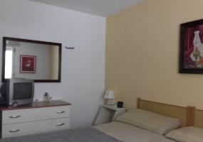 nella foto vediamo una camera da letto di una casa vacanze in Puglia a Pescoluse